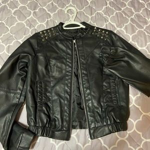 "Black ""leather"" jacket"